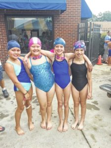 Dolphins swim to 4th place finish