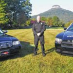 Pilot Mountain commissioners retire Captain Michael Palmer's badge and gun